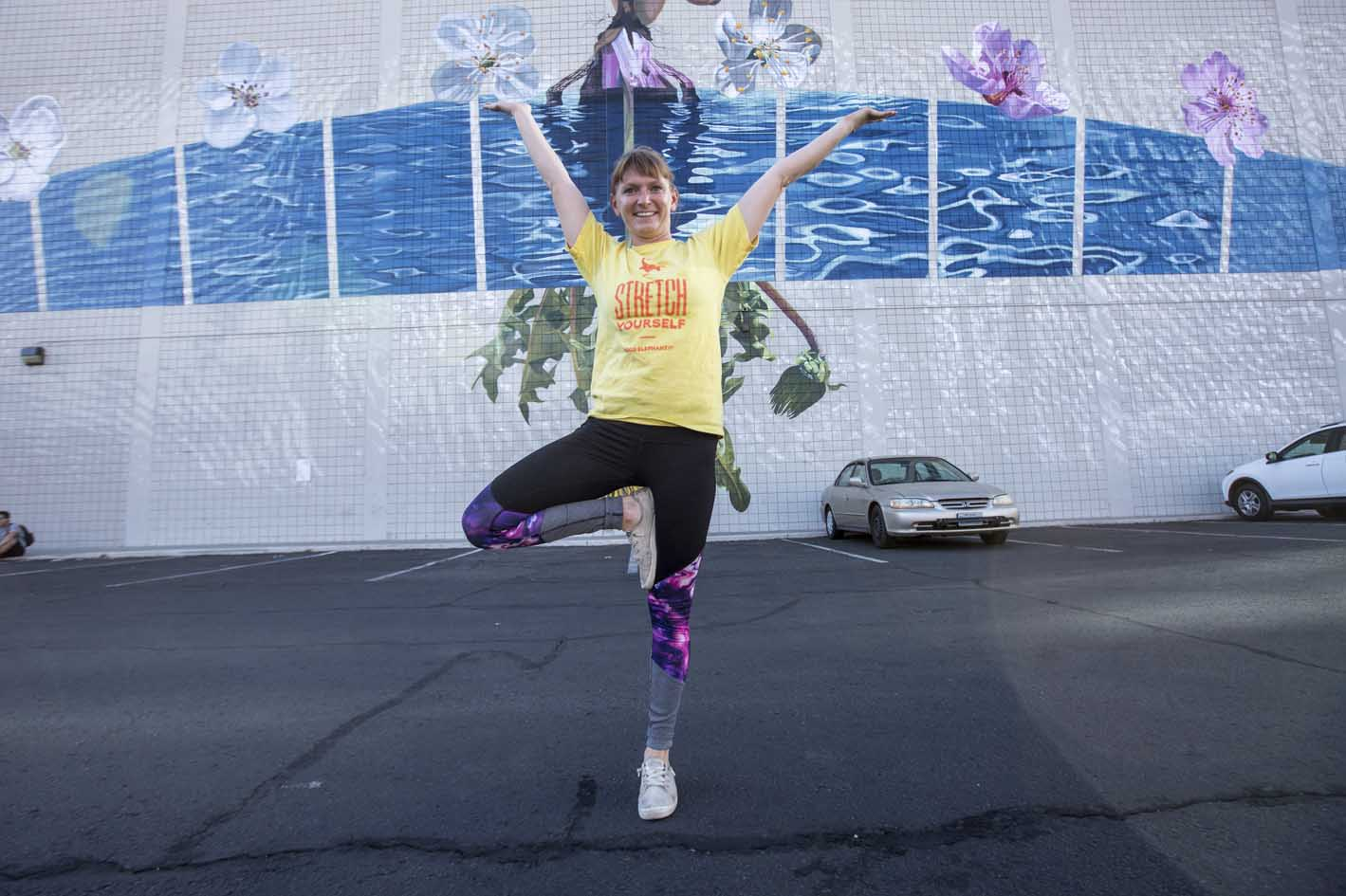 Image of Allison striking a tree pose