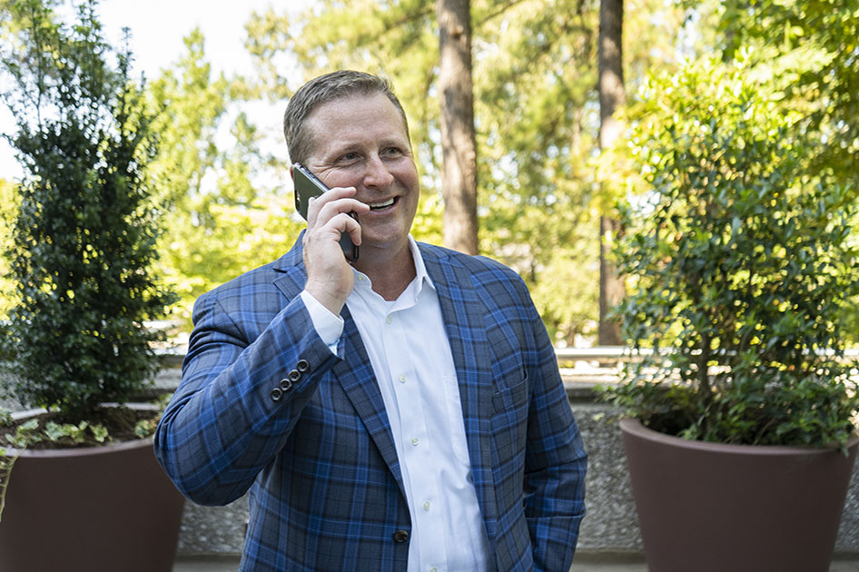 Jason is on the phone with clients